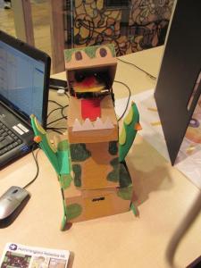 A dinosaur robot made using the Hummingbord kit.  Rowr!  Photo by Birdbrain Technologies