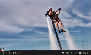 Man on jetpack, obeying Newton's Third Law.